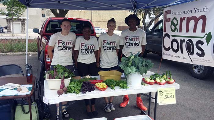 Youth Displaying Homegrown Crops - Racine Area Youth Farm Corps